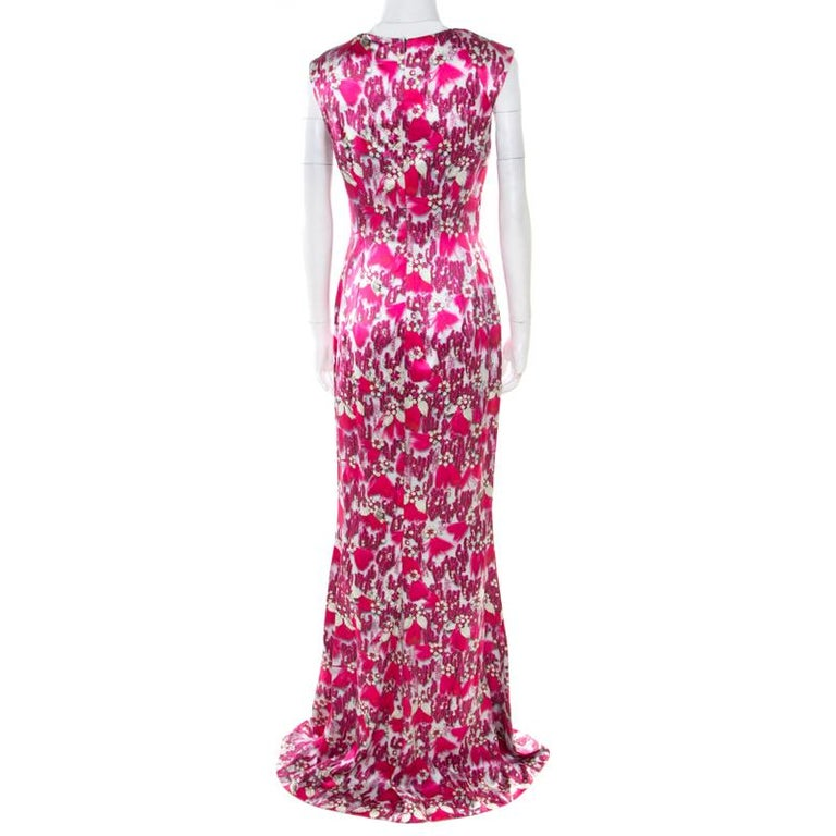 We've fallen in love with this gorgeous evening gown from Mary Katrantzou! The lovely fuchsia pink creation is made of 100% silk and features a bejewelled feather print all over it. It flaunts a bateau neckline and comes equipped with a concealed