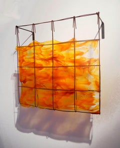 Southern Sunset, a glass and metal orange wall sculpture by Mary Shaffer