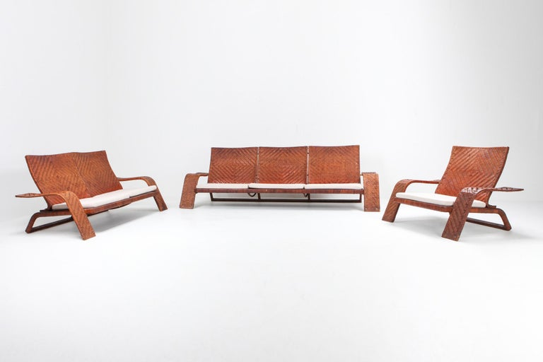 Postmodern sofa by Marzio Cecchi for Studio Most.  Woven leather frame in diamond patterns finished with brass details. finished with newly upholstered linen cushions. High end and custom made piece with amazing patina. This lounge chair is