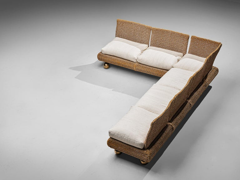 Marzio Cecchi for Studio Most, sectional sofa, metal, bronze, rope and upholstery, Italy, circa 1977.  Large sectional sofa by Marzio Cecchi features a bulky design with a woven rope frame. The seat rests on large bronze spheres, creating a more