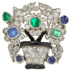 Marzo Platinum Brooch with Emeralds, Diamonds, Blue Sapphires, Circa 1920