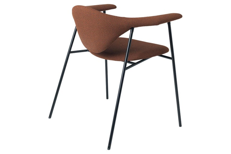 The Masculo chair by GamFratesi marries the idea of Danish elegance and simplicity with Italian refinement and playfulness. The backrest of Masculo is almost overly large, which call to mind a bull, and appears to float in the air and challenges all