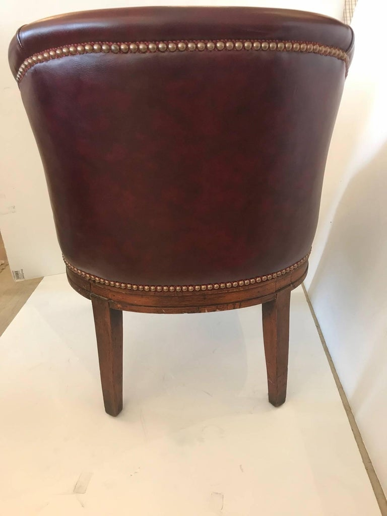 Very Handsome English Barrel Shaped Tub Chair Newly Covered In Rich Burgundy Leather And Finished With