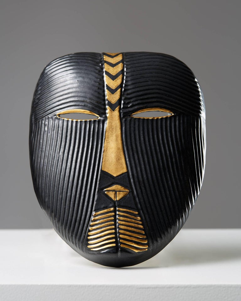 Mask designed by Lisa Larsson,  Sweden, 1950s.   Stoneware and hand-painted decor.  Probably unique in this decor.  Measures: H 21.6 cm/ 8 1/2