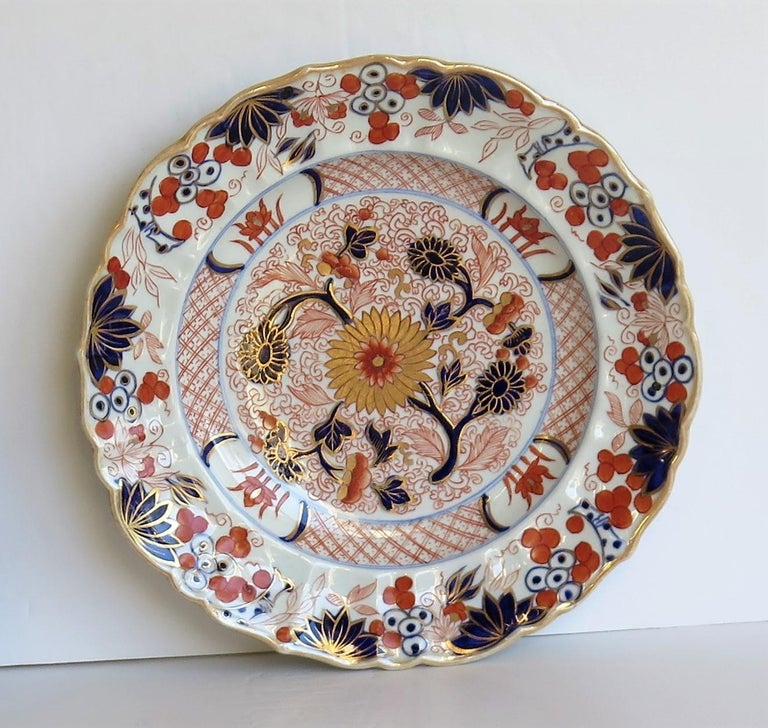 This is a very decorative, beautifully decorated ironstone pottery desert plate or dish in the gold Chrysanthemum pattern, produced by the Mason's Factory at Lane Delph, Staffordshire, England, circa 1818. This is a rare pattern.  The plate is