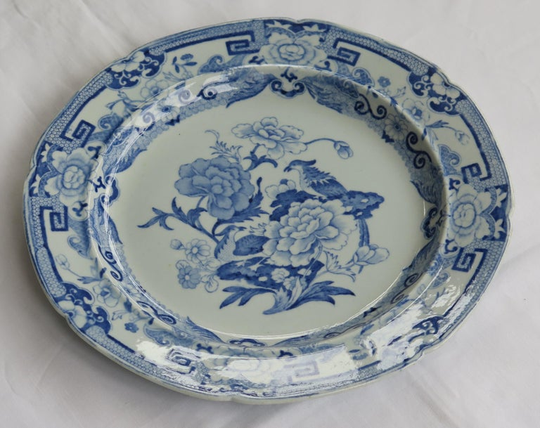 This ironstone pottery dinner plate was made by the Mason's factory at Lane Delph, Staffordshire, England and is decorated in the blue and white India Pheasants pattern, fully stamped and dating to the earliest period of Mason's Ironstone