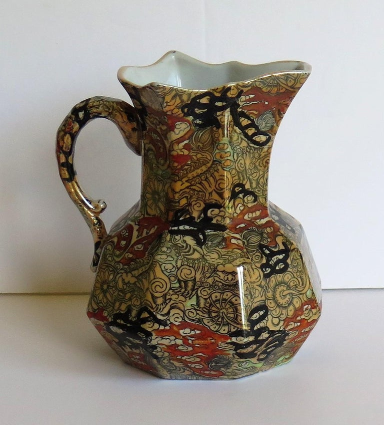 This is a very good hydra jug or pitcher decorated in the Bandana pattern and made by Mason's Ironstone, England in the 19th century, circa 1870.  The jug is octagonal in shape with the snake handle. These jugs were made in a range of sizes,