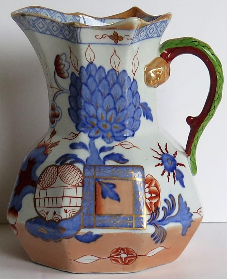 This is a very good Ironstone hydra jug or pitcher in the jardinière pattern and made by Mason's Ironstone, England, circa 1870.  The pattern is a known Mason's chinoiserie pattern called