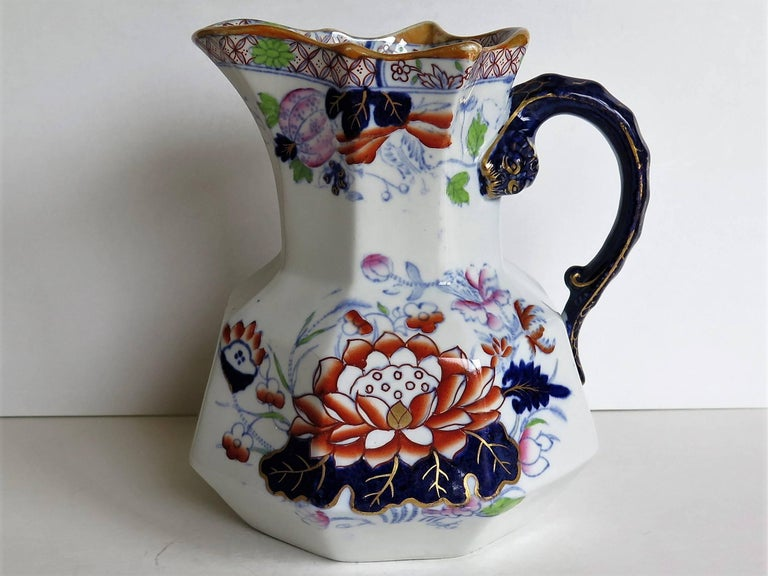This is a very good jug or pitcher by Mason's ironstone, England, circa 1880.  The jug has the Hydra shape with the snake heads handle with lower spur.   This jug has one of the very decorative and sought after oriental, Chinoiserie patterns