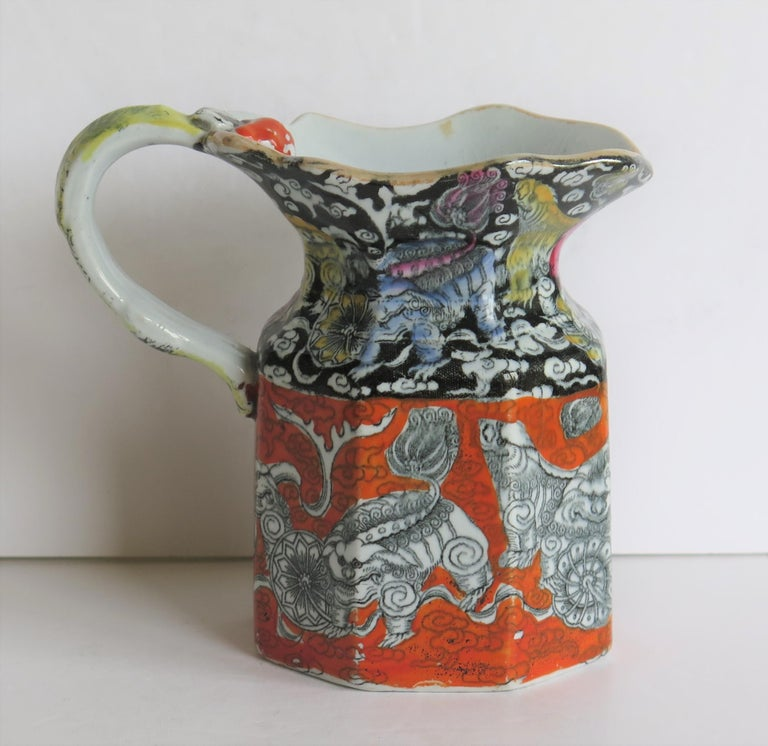 This is a very decorative Jug or Pitcher by Mason's Ironstone pottery, in the striking Bandana pattern, made in the mid-19th century, Circa 1840.   The jug is hand decorated over a transfer printed pattern with the striking chinoiserie influenced