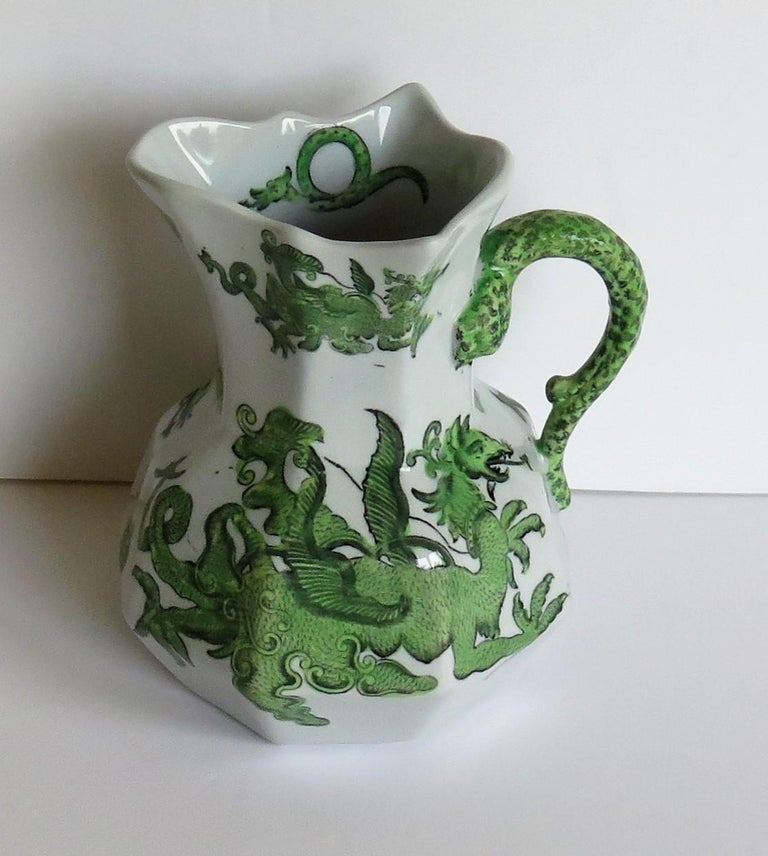 This is a very good Hydra jug or pitcher, made by Mason's Ironstone, England in the Chinese Dragon Pattern and dating to the 19th century, circa 1880.  The jug is octagonal in shape with the snake handle. These jugs were made in a range of sizes,