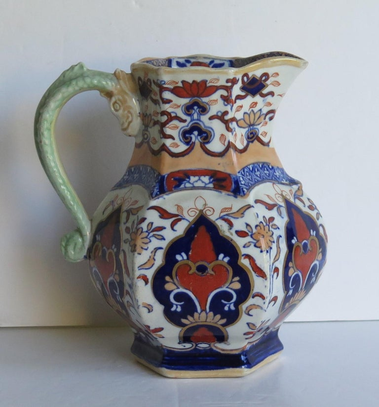This is a very decorative fairly large & well hand painted, Jug or Pitcher made by Mason's ironstone pottery, circa 1830.  It has a rare shape and pattern.  A jug of the same shape and pattern is illustrated on Page 192, Plate 245 of Godden's