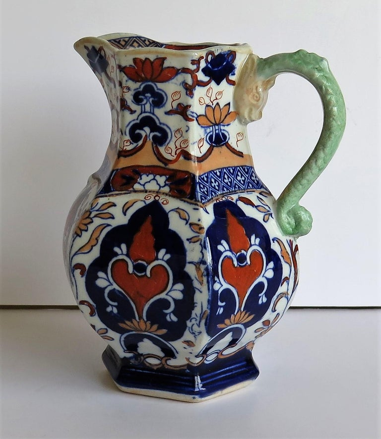 This is an unusual jug or pitcher made by Mason's ironstone pottery, circa 1830.  It has a rare shape and pattern.  A jug of the same shape and pattern is illustrated on Page 192, Plate 245 of Godden's guide to Mason's China and the ironstone