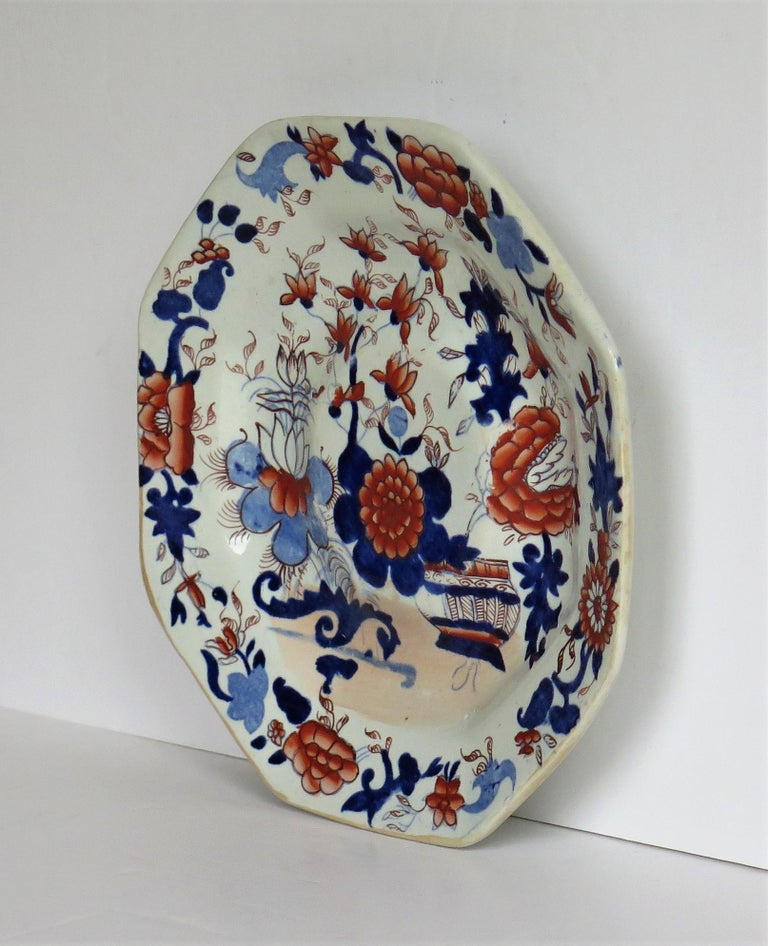 This is a very early octagonal footed plate, dish or stand in the Japan Basket Pattern by Mason's Ironstone, Lane Delph, England, dating to circa 1815.  The piece is well potted in an octagonal shape, on a raised foot with a slightly raised