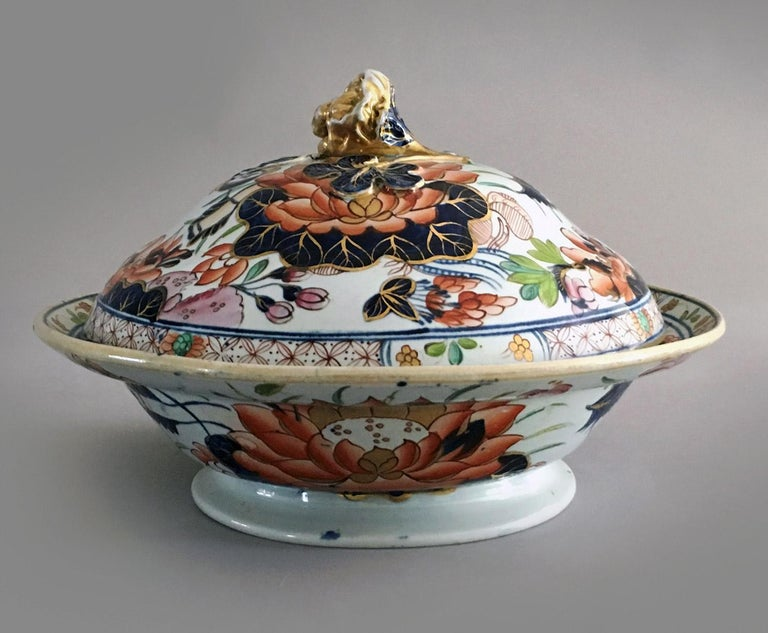 """Antique Mason's ironstone """"Water Lily"""" pattern partial dinner service, decorated with the central theme of a large water lily surrounded by various flowers and foliage with a diaper border of red stylized flowers, in a lushly polychrome Imari"""