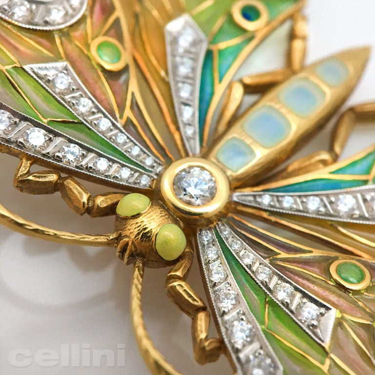 This stunning Masriera 18-karat yellow gold Butterfly brooch/pendant with multi-color plique-à-jour enameling is delicately detailed with brilliant-cut diamonds and four pearls. The Brooch has two loops on the underside which can easily attach to a