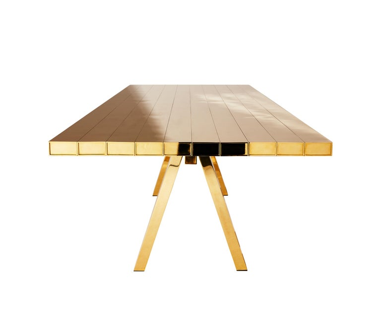 A family of super-polished solid brass tables manufactured in the UK and made from one single extruded box section of brass. By using the most familiar unit in furniture construction – the plank – and presenting a series of familiar objects in