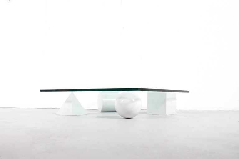 Impressive Metaphora coffee table in very good condition.  This coffee table is designed by Massimo & Lella Vignelli in 1979  Four forms of the Euclidean geometry, the cube, the cylinder, the sphere and the pyramid, made of Carrara marble, represent
