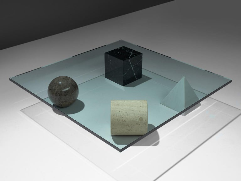 Lella and Massimo Vignelli, 'Metafora' cocktail table, glass, travertine and marble, Italy, 1970s.  This Metafora table is designed by Lella and Massimo Vignelli. This table combined out of four geometric shapes: a cube, a cylinder, a ball and a