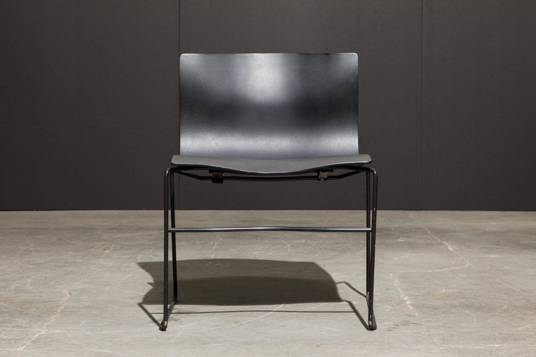 This classic Post-Modern design by Massimo and Lella Vignelli for Knoll International is called the 'Handkerchief' stacking chair, labelled underneath with early production (original) year labels. We have over 60 of these available, in black powder