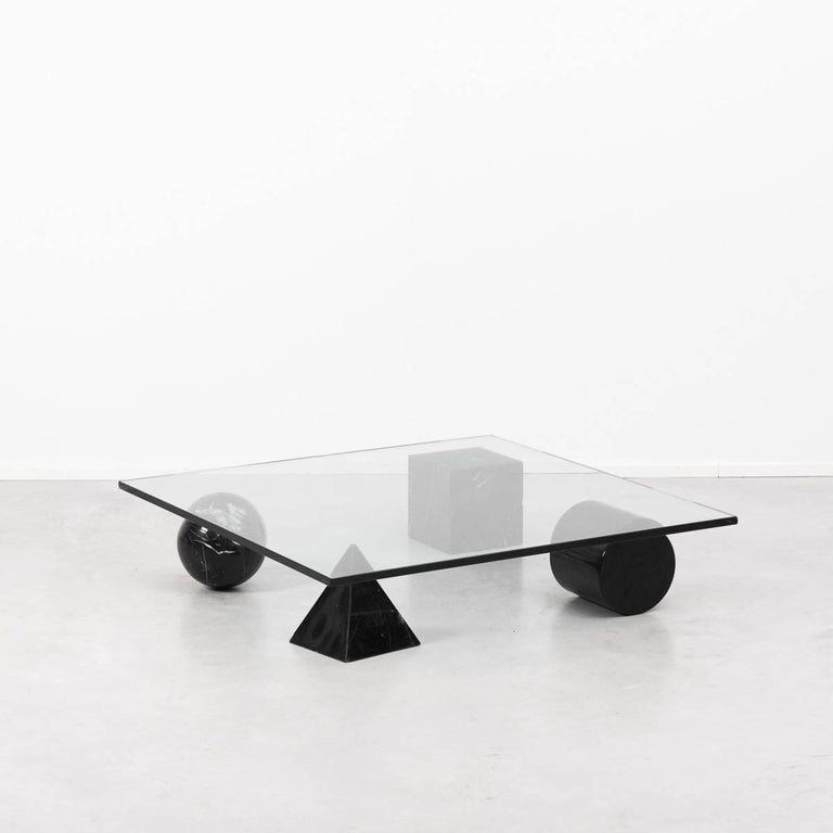 A stunning and sculptural coffee table inspired by the four forms of Euclidean geometry, the cube, the pyramid, the cylinder and the sphere. The four elements can be positioned freely for a unique composition.  The elements are made from black