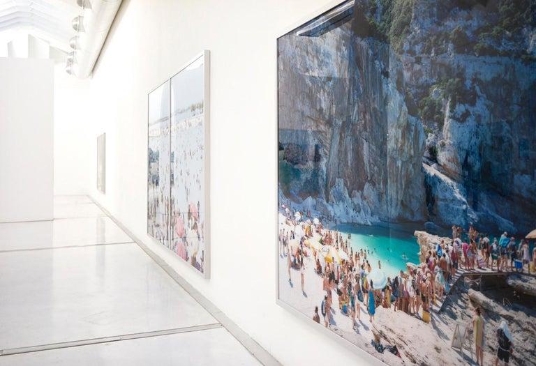 Cala Conta Evening - Large scale Mediterranean beach scene (artist framed) - Blue Landscape Photograph by Massimo Vitali