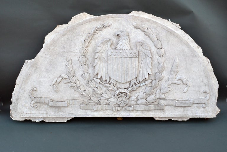 Massive American antique Plaster demilune plaque with American eagle and shield, 1900-1930  The gray plaster bas-relief wall plaque depicts a large American eagle and shield. It was originally made for a Pennsylvania bank building.  One can see