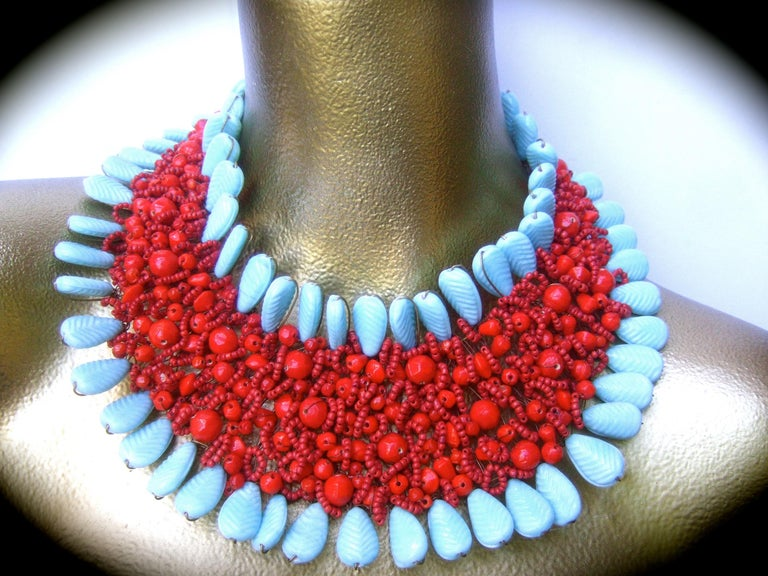 Massive glass beaded handmade artisan choker bib collar necklace 21st c  The bold avant-garde large scale wide choker bib necklace is comprised of a collection of pale aqua blue glass stones that frames the border edges. The collection of