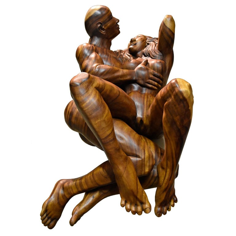 Masterfully hand carved from what must have been a colossal solid piece of monkey pod hardwood. This nude figural sculpture weighs around 250 lbs. Although our photos are an adequate representation, the authentic real life presentation of this work