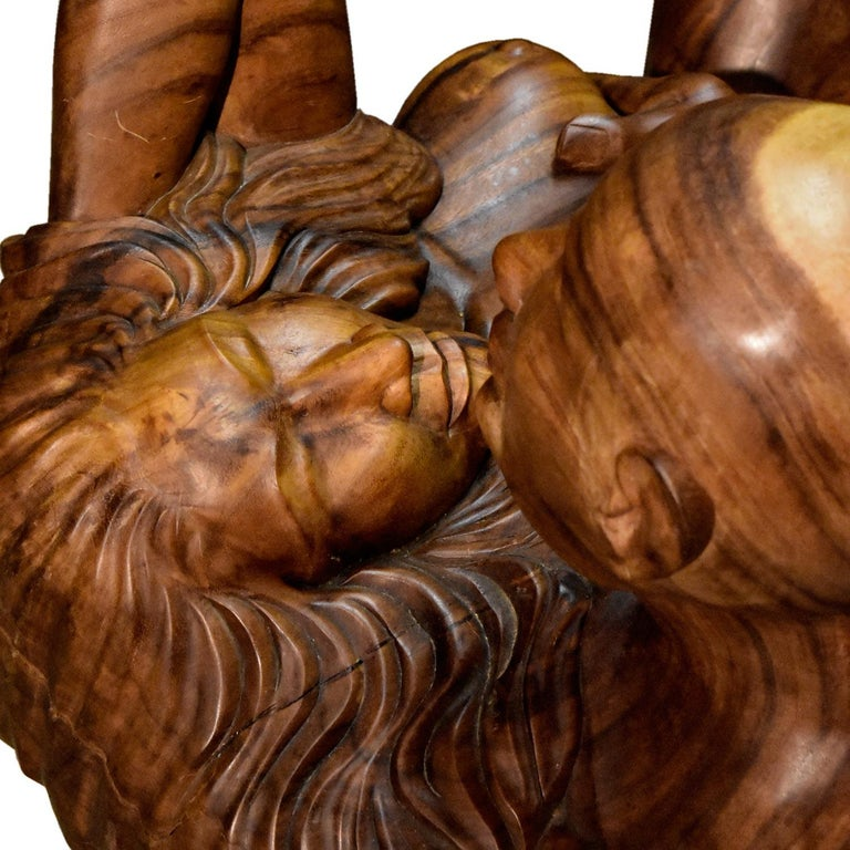Massive Hand Carved Monkey Pod Exotic Hardwood Lovers Embrace Coffee Table In Good Condition For Sale In Saint Petersburg, FL