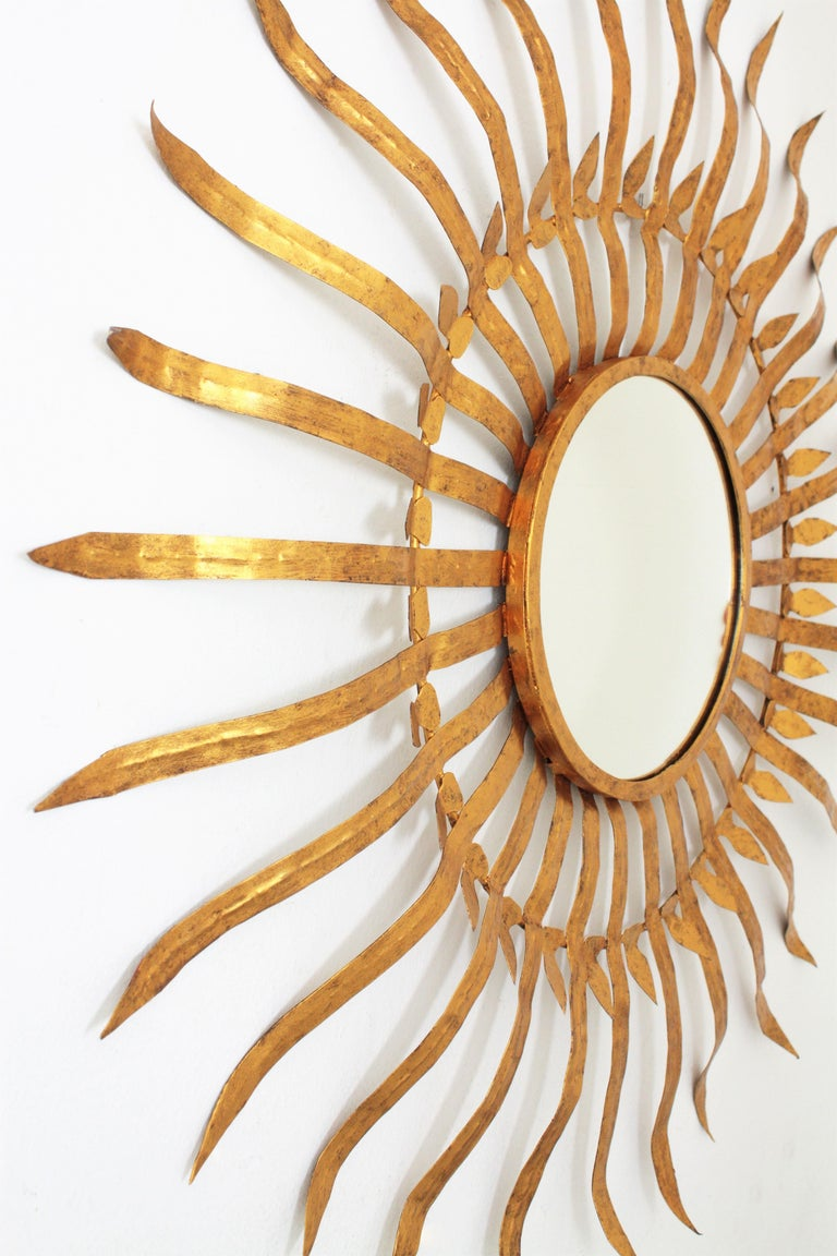 Spanish Massive Hollywood Regency Gilt Wrought Iron Convex Sunburst Mirror, Spain 1950s For Sale
