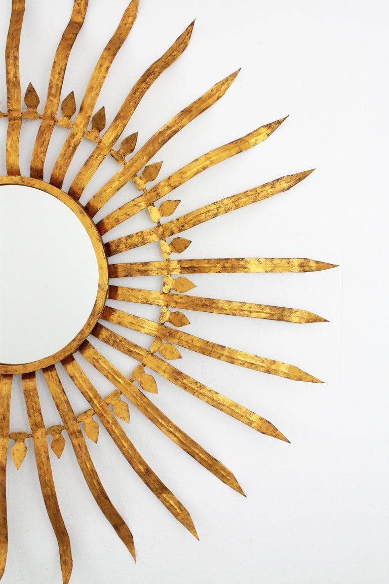 20th Century Massive Hollywood Regency Gilt Wrought Iron Convex Sunburst Mirror, Spain 1950s For Sale