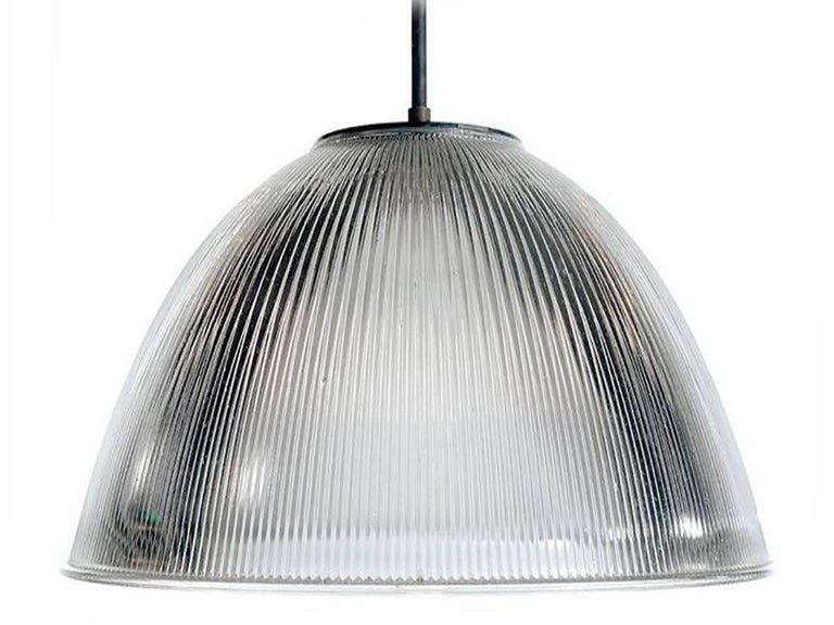 This is the biggest single piece glass shade that we have ever offered. In places the glass is half inch thick in a deep prismatic pattern. The diameter is 25.5 inches and 17 inches tall plus pipe to your length. The mounting plate is as clean and