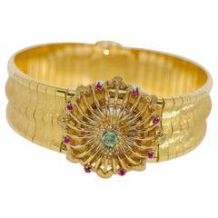 Massive Ladies Wristwatch, Bracelet, 18 Karat Gold, with Rubies and Emerald