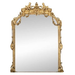 Massive Mid 19th C. Carved and Gilt Mantle Mirror with Putti Crest