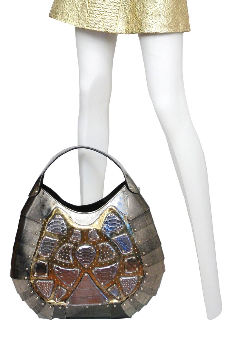 A highly rare and important one-of-a-kind silver exotic skins leather and tarnished silver colored metal giant scale handbag. In Memory Of Elizabeth How, Salem 1692 collection AW 2007. McQueen had bag made custom for and exhibition. The bag has only