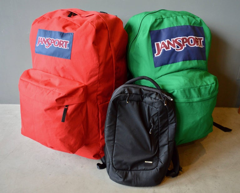 Massive oversized Jansport backpacks. One red. One green. Over 2.5 feet tall. 400% larger than a normal backpack. Cool advertising piece. Great object for a kids room. Priced individually.