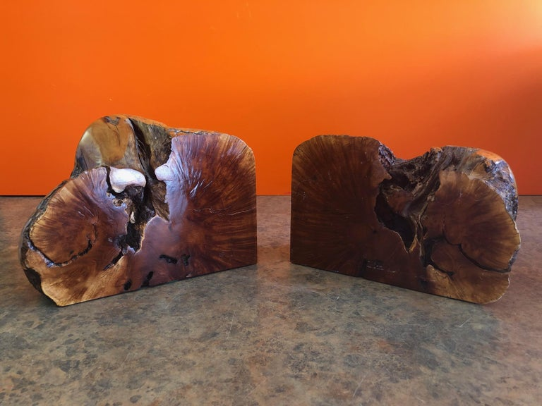 A very cool and unique pair of burl wood Bookends, circa 1960s. Wonderful colors and texture on these massive and heavy bookends; each one measures approximately 8.25