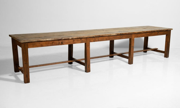 Massive pine worktable, Italy, circa 1900.  Beautifully patinated wood with stretcher supports and two large drawers on each end.
