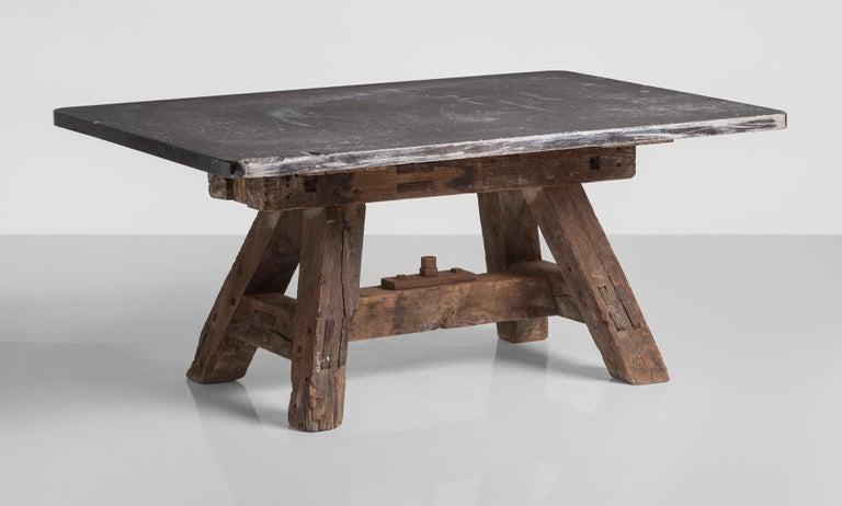Massive pottery table, France, circa 1950  Thick slab top sits on a substantial A-frame base.