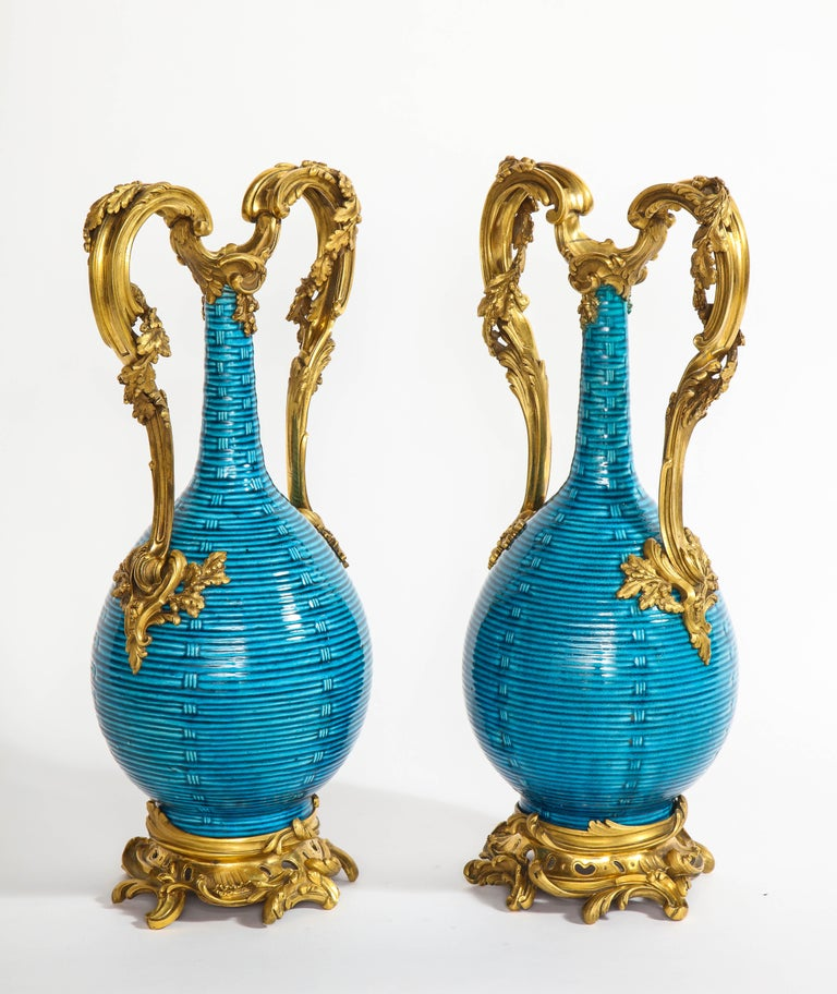 A magnificent and exceptional pair of massive antique French 18th century Louis XV period doré bronze and Chinese Turquoise ground porcelain hand engraved basket weave form vases. The porcelain, Chinese and first half of 18th century and the ormolu,