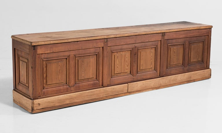 All pine unique shop counter with original iron pulls, and finished back.