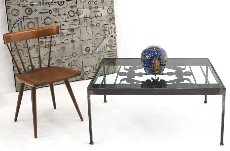 Ornate 39 x 34 rectangle heavy gage wrought iron thick glass top coffee table.