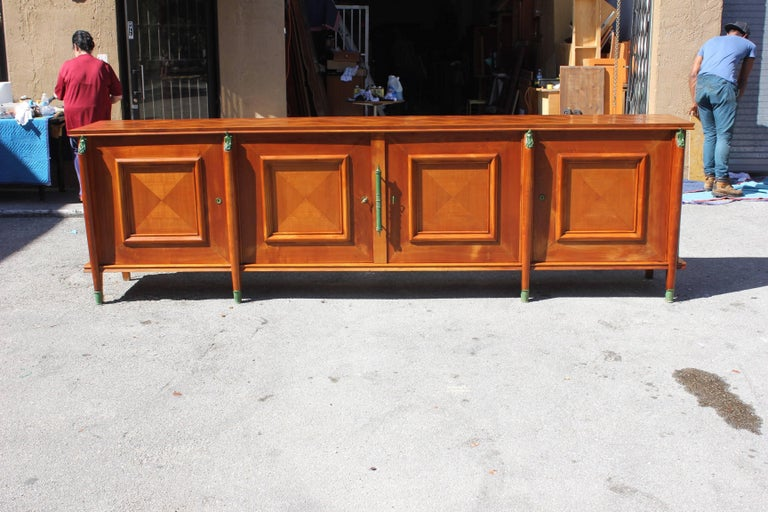 Master piece French Art Deco sideboard or buffet cherrywood by Leon Jallot circa 1930s, beautiful sideboard with four saber legs with green bronze sabot feet, and four green bronze figure man and women and top of the saber legs, very long sideboard