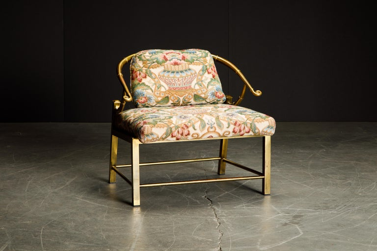 This beautiful lightly patinated brass slipper chair by Mastercraft is signed underneath with Made in Italy label. This gorgeous empress chair by Mastercraft shares design cues with James Mont with its asian influences, designed by Charles Pengally