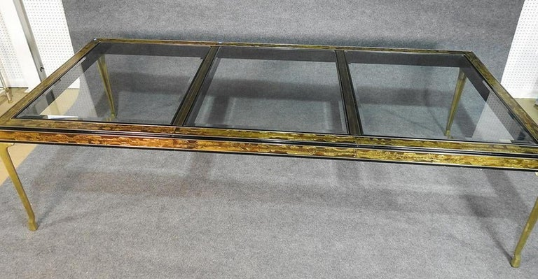 Acid etched brass on ebonized wood frame with beveled glass inserts on brass legs. 
