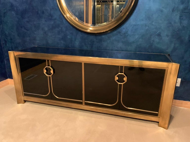 This glamorous sideboard is from a particularly ultra deluxe collection by Mastercraft Furniture Company designed by William Doezema where the quality of materials and finishes were executed to an exceptionally high standard. Shaped solid brass