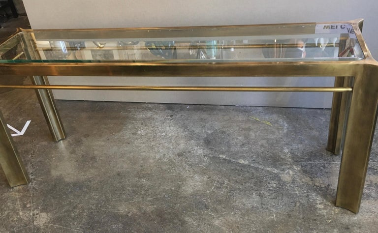 Mastercraft brass and glass console table.
