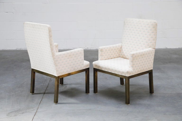 This super cute set of four (4) dining armchairs by Mastercraft feature a brass base with light patina and a very unique and interesting fabric that features light pink and baby blue flowers over an off-white knit. The fabric resembles what I would