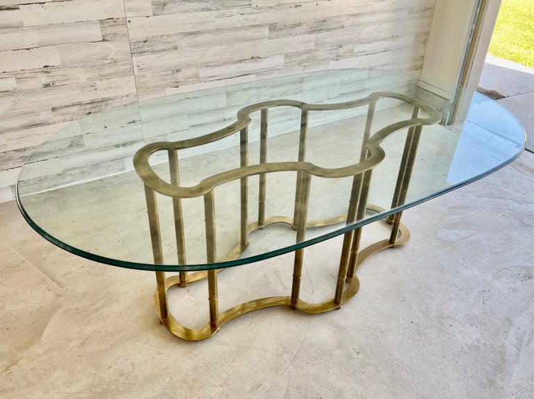 Massive Mastercraftbrass base faux bamboo dining table with thick beveled glass top. Original Made in Italy label still attached. Base measures: 55.25 L x 27.5 D x 28.25 H.